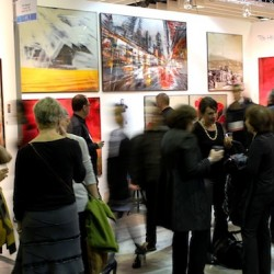 Tibi Hegyesi's booth at Art Expo New York is full of visitors
