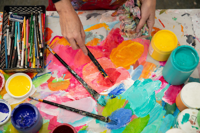 Betty Franks mixing paints in her studio Organizing digital images - photo by Liza Head | for Art Biz Success